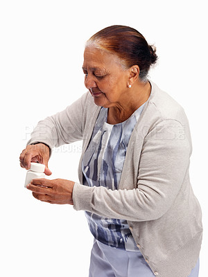 Buy stock photo Elderly woman trying to open a bottle against white background