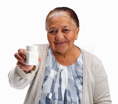 Buy stock photo Elderly woman showing you a pill bottle against white background