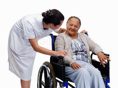 Buy stock photo Portrait of a young nurse with a senior woman on wheelchair looking at eachother