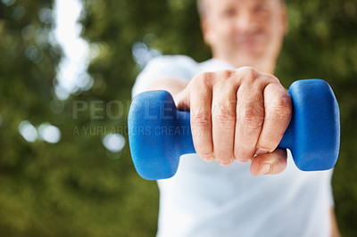 Buy stock photo Closeup mid section of a blue dumbbell being held by a man outdoors