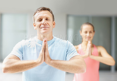 Buy stock photo Handsome and fit man practicing yoga with a woman at the gym