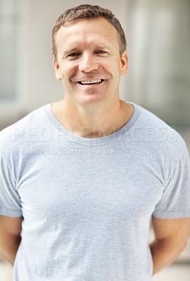 Buy stock photo Portrait of a handsome mature man standing and smiling