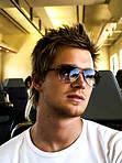 Trendy Young Man in a bus or train - Being cool in public transportation