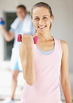 Happy woman working out at the gym to lose weight