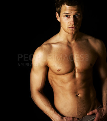 Buy stock photo Studio portrait of a handsome bare-chested male model isolated on black