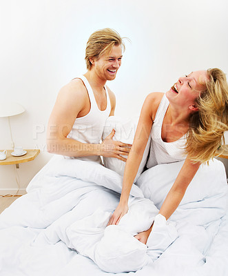 Buy stock photo A sensual and cute couple fighting for fun.