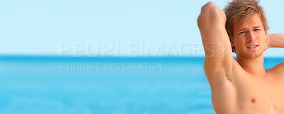 Buy stock photo A beautiful young man taking in the sun at the beach in Denmark Panorama or banner, lots of room for text.