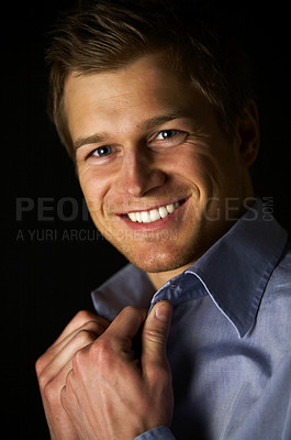 Buy stock photo Confident businessman - A trendy businessman with a blue shirt.