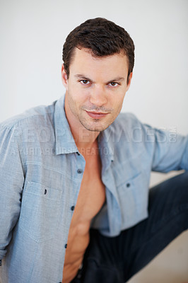 Buy stock photo Portrait of sexy muscular man showing his body