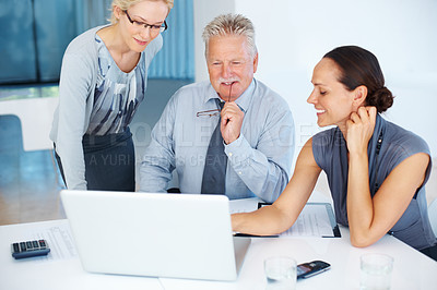 Buy stock photo Portrait of senior business man with female colleagues working on project using laptop in office