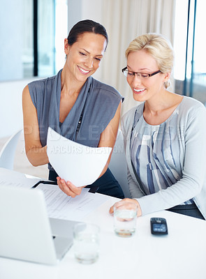 Buy stock photo Portrait of happy female executives discussing with document