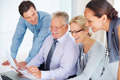 Buy stock photo Team of smiling business people having a fun conversation with each other in office