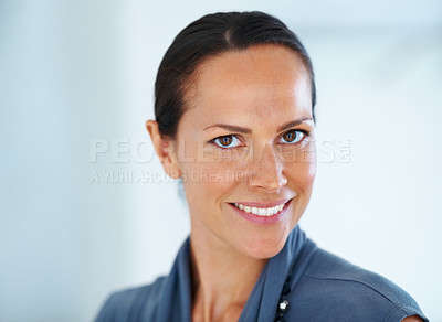 Buy stock photo Closeup of confident mixed race business woman smiling