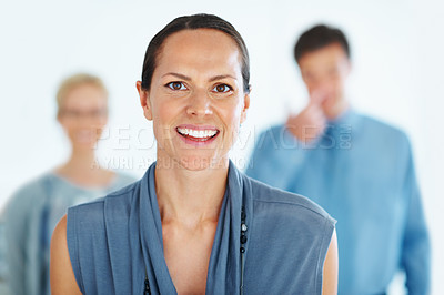 Buy stock photo Portrait of smiling business woman with her colleagues in background