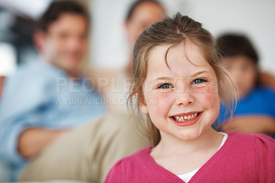 Buy stock photo Closeup portrait of smiling little girl with family in background