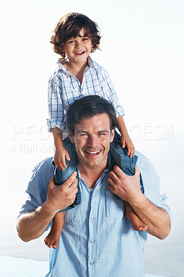 Buy stock photo Portrait of cute little boy sitting on father's shoulder