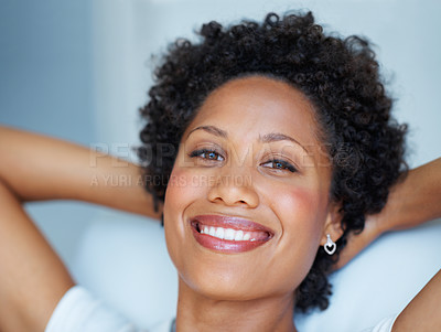 Buy stock photo Closeup portrait of beautiful African American woman relaxing with hands behind head