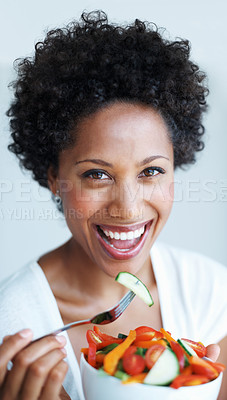 Buy stock photo Closeup of beautiful African American woman eating vegetable salad