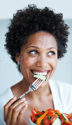 Buy stock photo Closeup of beautiful African American woman eating healthy food while looking away