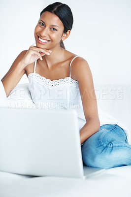 Buy stock photo Portrait of beautiful mixed race woman relaxing at home with laptop