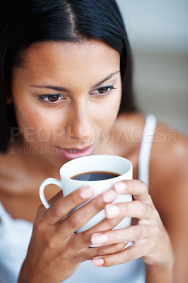 Buy stock photo Closeup of a beautiful woman drinking a relaxing cup of coffee