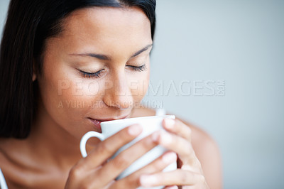 Buy stock photo Closeup of relaxed mixed race woman having coffee with eyes closed