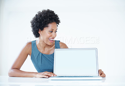Buy stock photo Closeup of smiling business woman displaying laptop