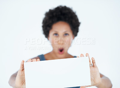 Buy stock photo Surprised African American woman showing blank card