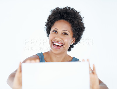 Buy stock photo Smiling African American woman displaying blank card on white background