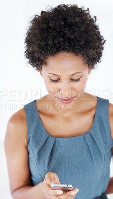 Buy stock photo Portrait of African American woman reading text messages on cellphone