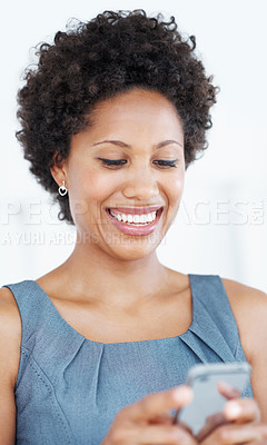 Buy stock photo Portrait of happy African American business woman reading text on her mobile phone on white background