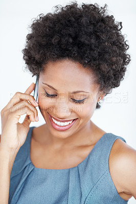 Buy stock photo Closeup of attractive business woman smiling while conversing on mobile phone on white background
