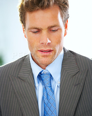 Buy stock photo Nervous Mature businessman looking down