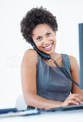 Buy stock photo Portrait of attractive female executive smiling while talking on phone at office desk