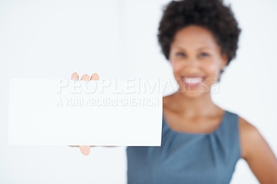 Buy stock photo Closeup of confident business woman showing blank card over white background
