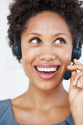 Buy stock photo Portrait of cheerful female customer service representative with headset smiling while looking away