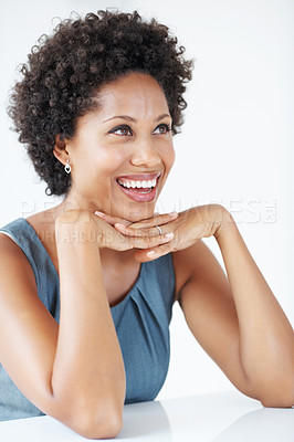 Buy stock photo Attractive African American business woman smiling with hands on chin