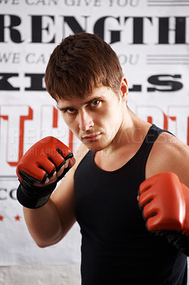 Buy stock photo Portrait of determined boxer focused on his fight and ready to attack