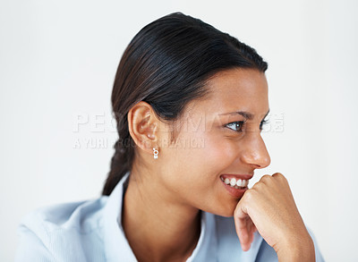 Buy stock photo Closeup of attractive female executive smiling while looking away