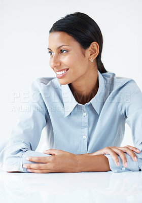 Buy stock photo Closeup of confident female executive smiling at desk