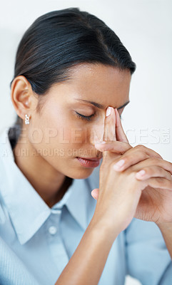 Buy stock photo Closeup of mixed race business woman suffering from severe headache