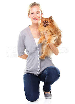 Buy stock photo Beautiful blonde kneeling while holding a cute pomeranian