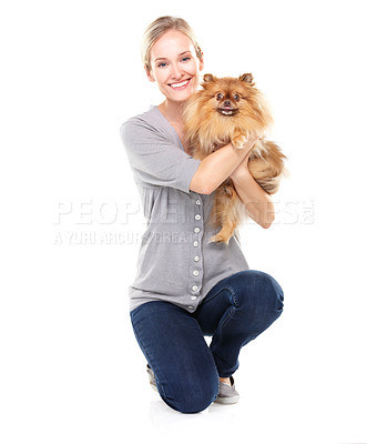 Buy stock photo Lovely blonde woman proudly holding up her cute pomeranian while kneeling