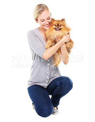 Buy stock photo Pretty blonde woman lovingly embracing her cute pomeranian dog