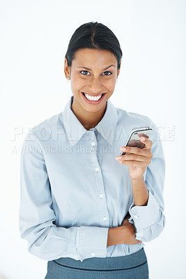 Buy stock photo Portrait of smiling mixed race business woman texting over white background