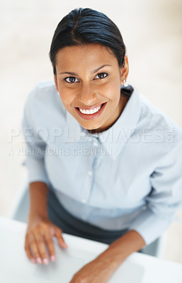 Buy stock photo High angle view of pretty mixed race business woman smiling at you