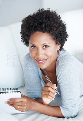Buy stock photo Beautiful young woman relaxing on couch with diary