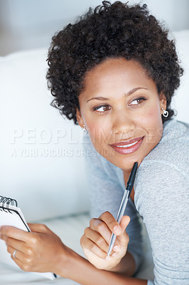 Buy stock photo Beautiful African American woman at home thinking while writing in diary