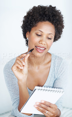 Buy stock photo Smiling African American woman thinking while writing on white background