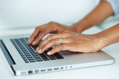 Buy stock photo Closeup of female hands typing on laptop keypad